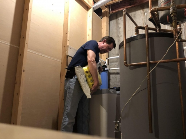 Tom puts the finishing touches on a new Hague WaterMax and whole house filter install in Evergreen to mitigate uranium, radon and to remove hardness.