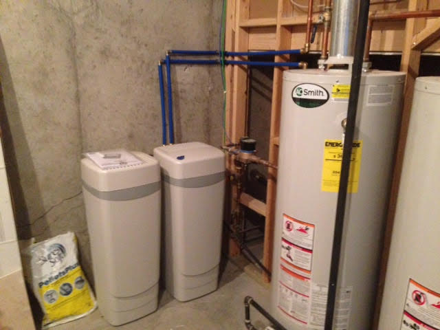 Whole house treatment system for hardness on city water
