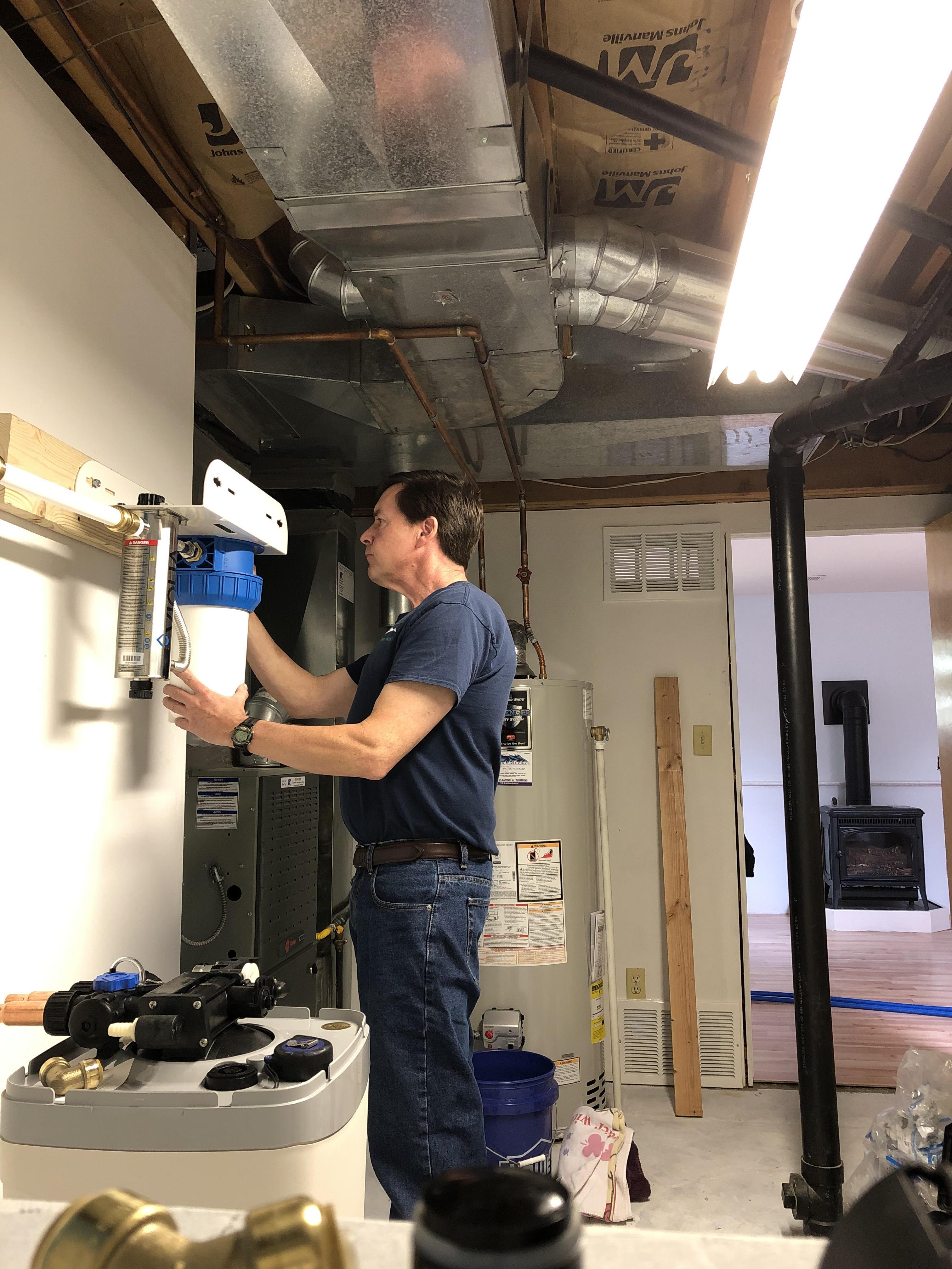 Tom finalizing UV - ultraviolet system install in Evergreen