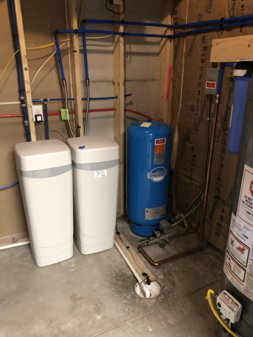 """Installation of a Hague WaterMax 2AMQ in Evergreen for sediment and hardness, preceded by a 20"""" """"Big Blue"""" GAC for low level radon mitigation. Clients chose the WaterMax because, among other things, its minimal water consumption during the regeneration process."""