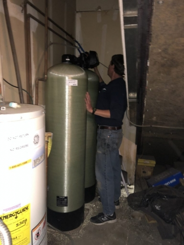 WQA MWS/CI Tom Kinnane inspects the settings on RMWC's new, commercial, twin alternating softener installation in Henderson, CO. Are you due for an upgrade?