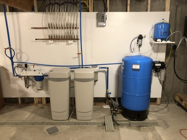 Hague WaterMax 2AJQ treats sediment, hardness, iron and raises low pH; UV with prefilter for bacteriological protection, Hague H3500 RO with booster pump supplying water to three locations in Evergreen, CO